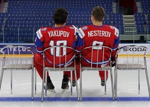 UFA, RUSSIA - DECEMBER 27: Russia's Nail Yakupov #10 and Nikita Nesterov #9 relaxing after the team photo - 2013 IIHF Ice Hockey U20 World Championship. (Photo by Andre Ringuette/HHOF-IIHF Images)