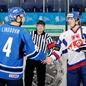 UFA, RUSSIA – JANUARY 4: Finland's Petteri Lindbohm #4 and Slovakia's Karol Korim #28 shake hands during relegation round action at the 2013 IIHF Ice Hockey U20 World Championship. (Photo by Richard Wolowicz/HHOF-IIHF Images)